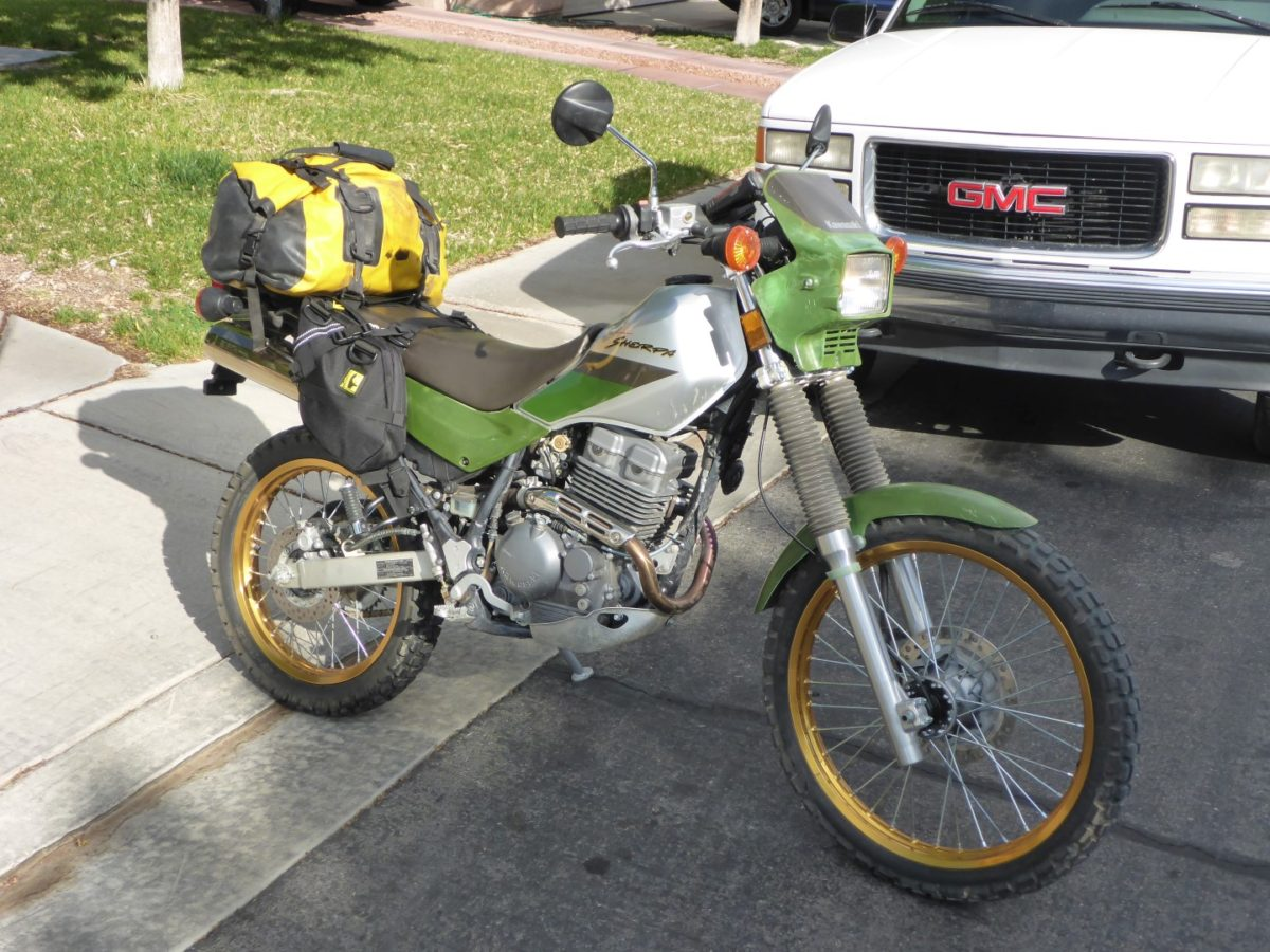 The Super Sherpa KL250G has KLR in it's blood and packs easily. I used Wolfman Daytripper bags and a small duffel on the back. I had more than enough room for everything.